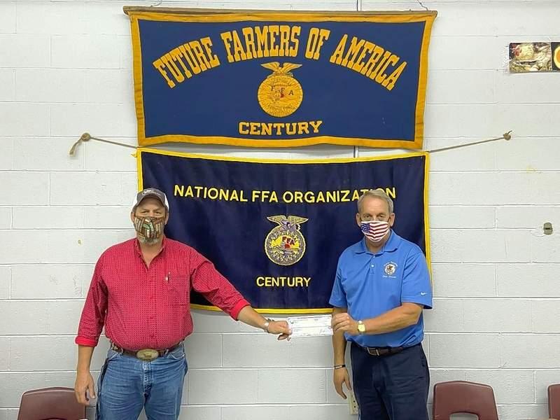 State Sen. Dale Fowler presents a $750 grant to Pulaski County FFA.