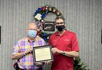 Longtime WEBQ radio personality Sonny Dotson, left, is honored by the city and Mayor John McPeek for his service to the community.