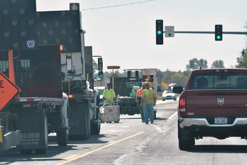 A road painting crew works on US 45/Illinois 145 near the intersection with Illinois 34 at the south end of Harrisburg on Wednesday.