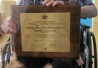 PHOTO COURTESY OF MEESHA BAUGHER WORLEY Ed Baugher Jr. displays his 75 year service award from the International Union of Bricklayers and Allied Craftworkers.