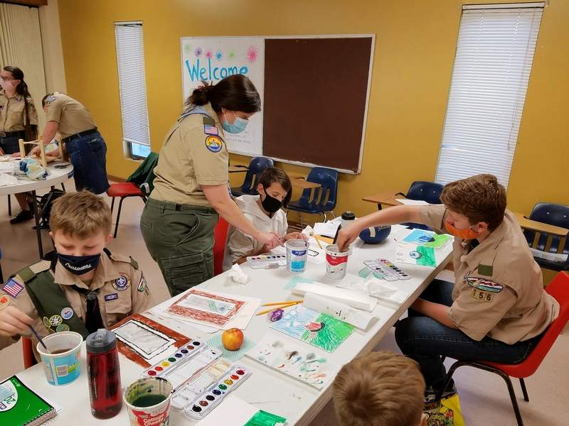 Sara DeNeal, a merit badge counselor for Art, instructs scouts during her Art merit badge course.