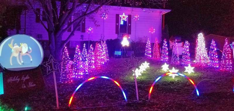A house decorated for the Saline County Tourism Board's Holiday Lights Contest greets visitors in Harrisburg.
