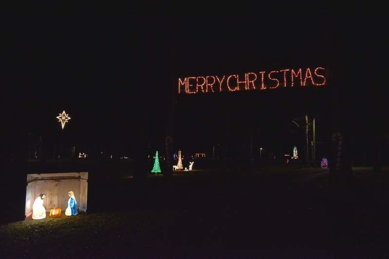 Visitors to Ridgway Park are greeted with one of several Nativity scenes and a 'Merry Christmas' display overhead.