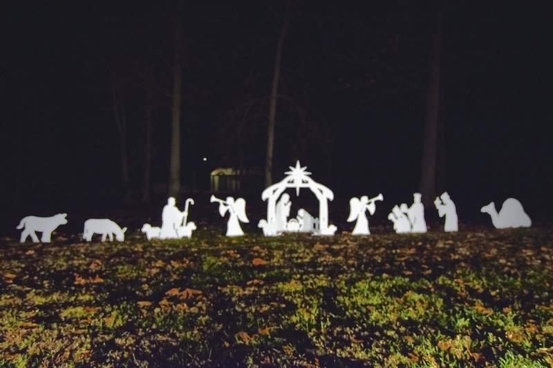 A white silhouette Nativity is featured at one end of Ridgway Park.