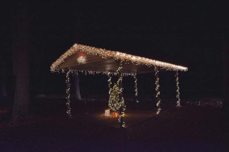 TRAVIS DENEAL PHOTOA small shelter with Christmas lights.
