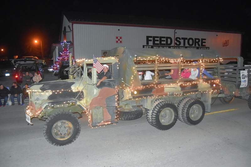 Aaron McCarty drives his military truck in the lights parade for The Horse Shack.