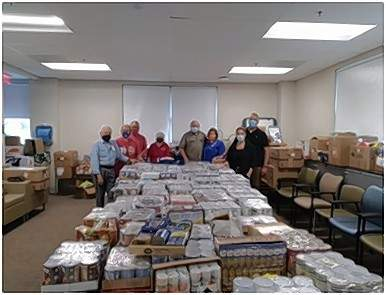 From left, DAR Veteran's Chairman Shelia Albright and other VA Pantry helpers unloaded hundreds of cans of food at conclusion of December drive:  Art Ambros, Dixie and Dale Barnhart, Debbie Ferguson, Joe and Shelia Albright, Tim and Marie Buehler.
