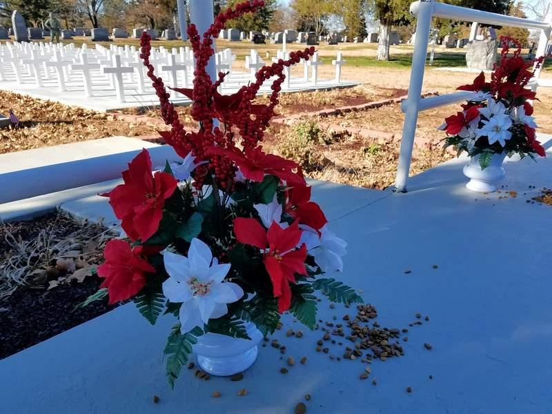 TRAVIS DENEAL PHOTODecorative poinsettias honor the fallen at Harrisburg's Veterans Memorial at Sunset Lawn Cemetery.
