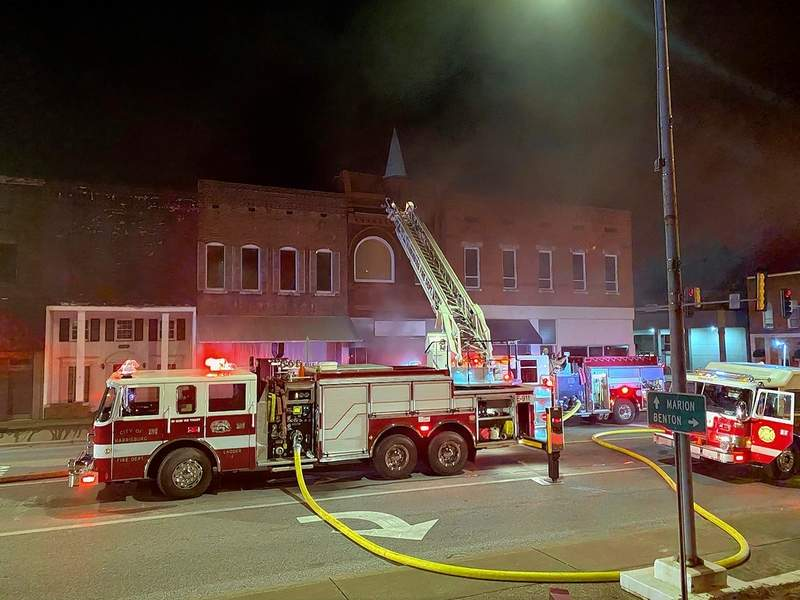Firefighters combat a blaze at Old 13 along Poplar Street on Harrisburg's square.