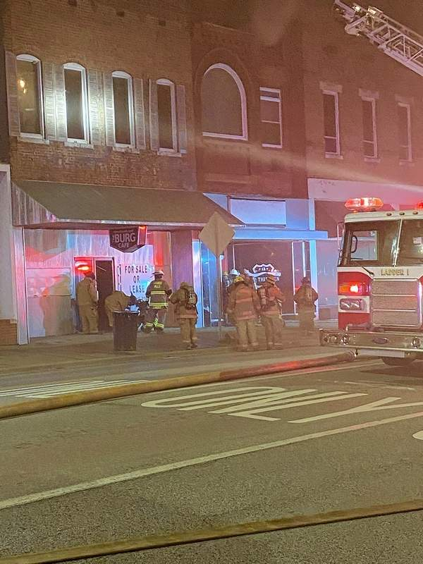 Firefighters work on fighting a fire at Old 13 on Poplar Street in Harrisburg Monday night.