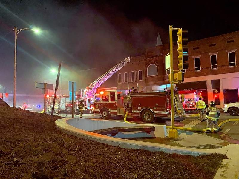 Firefighters extinguish a blaze at Old 13 on Poplar Street in Harrisburg Monday.