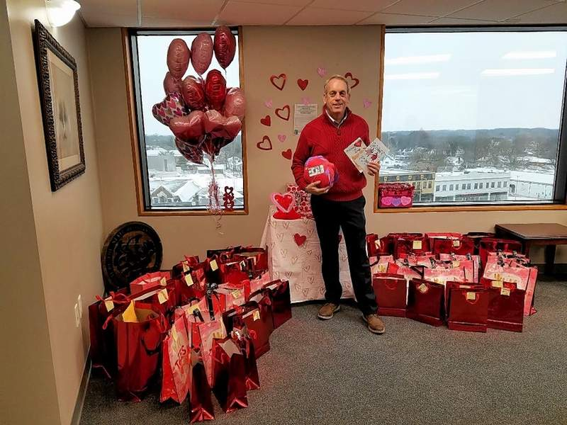 State Sen. Dale Fowler stands in his office in Harrisburg with a collection of Valentine's Day cards he and his assistants delivered on Friday to residents of nursing homes and assisted living centers.