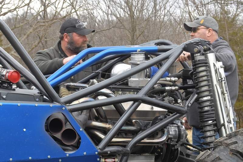 TRAVIS DENEAL PHOTOJedd Harper, left, talks with his friend Jim Pulley about the upcoming rock bouncer racing event at Williams Hill Pass.