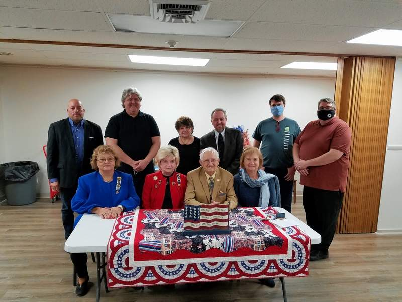Michael Hillegas DAR members, family and friends of Don Cooper met to celebrate Cooper's recognition from DAR, the Illinois State Senate and Congress. Front row from left are Michael Hillegas Veterans Chairman Shelia Albright, Michael Hillegas Regent Kathy Morris, Don Cooper and Michael Hillegas Chaplain Cheri McClusky. Back row, from left, are Andy Sisulak, representing Illinois state Sen. Dale Fowler, Saline County Board member Jonathan Russell, Linda Cooper, Terry Cooper, Garrett Rowe and Travis Akin, representing U.S. Rep. Mary Miller.