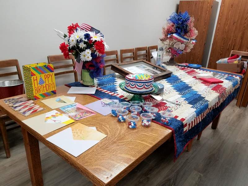 TRAVIS DENEAL PHOTOMichael Hillegas DAR members decorated for Don Cooper's reception with a patriotic theme.