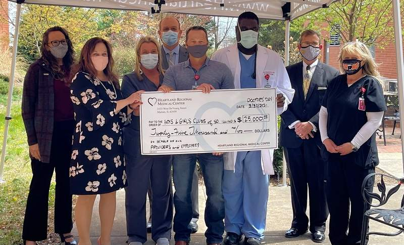 Members of the Medical Executive Committee and Administration presented a $25,000 check to the Boys and Girls Clubs of Southern Illinois on Tuesday.