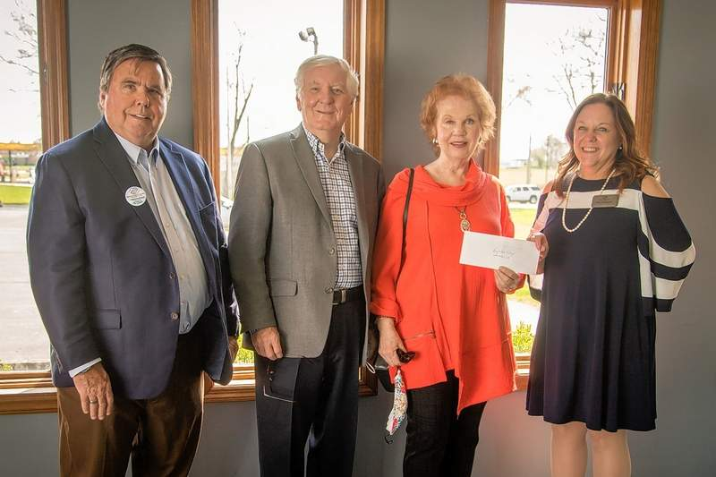 Scott Murrie left, Marion Task Force and Tina Carpenter right, CEO, BGCSI accept a donation of $10,000 from Glenn and Jo Poshard of The Poshard Foundation for Abused Children.