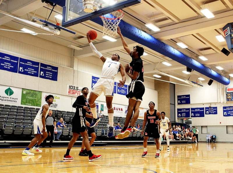 John A. Logan College freshman Dre Boyd goes up against Wabash Valley's Darius Osbourne in the first half Wednesday during the semifinals of the Region 24 Tournament.