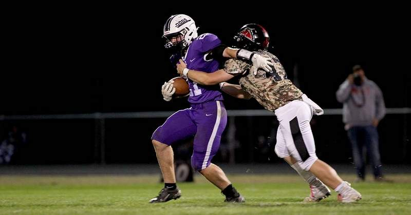 Harrisburg running back Ross Rider is wrapped up by Fairfield defender Konnor Dagg in the second half Friday at Taylor Field in Harrisburg.