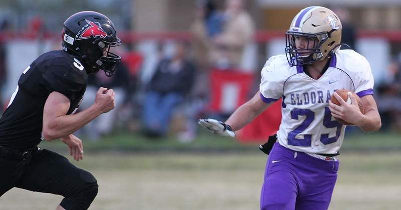 Dylan Henshaw looks to make a move on Fairfield's Lucas Halbert in the first half Friday.