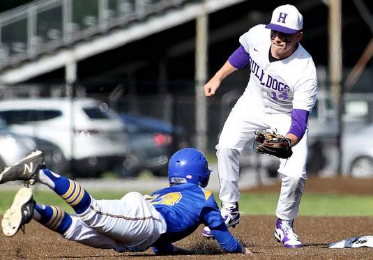 Harrisburg second baseman Javie Beal applies this tag to Trico's Keegan Brooks on an attempted steal in the third inning Wednesday at Jay Thompson Field.