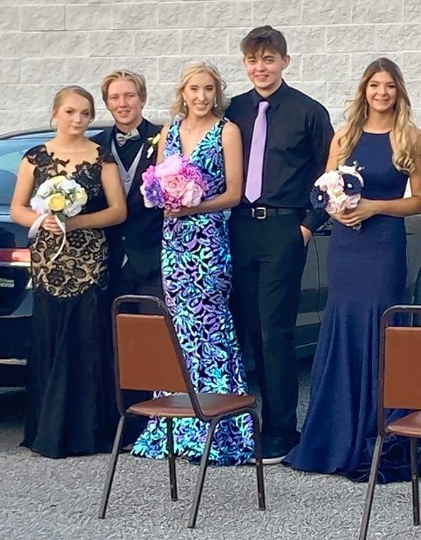 Prior to the Carrier Mills-Stonefort High School prom, Jersey Willis of Harrisburg, Brandon Banks of Harrisburg, Hannah Proctor of Harrisburg, Eli Grathler of Carrier Mills and Missy Chamberlain of Harrisburg pose for a photo.
