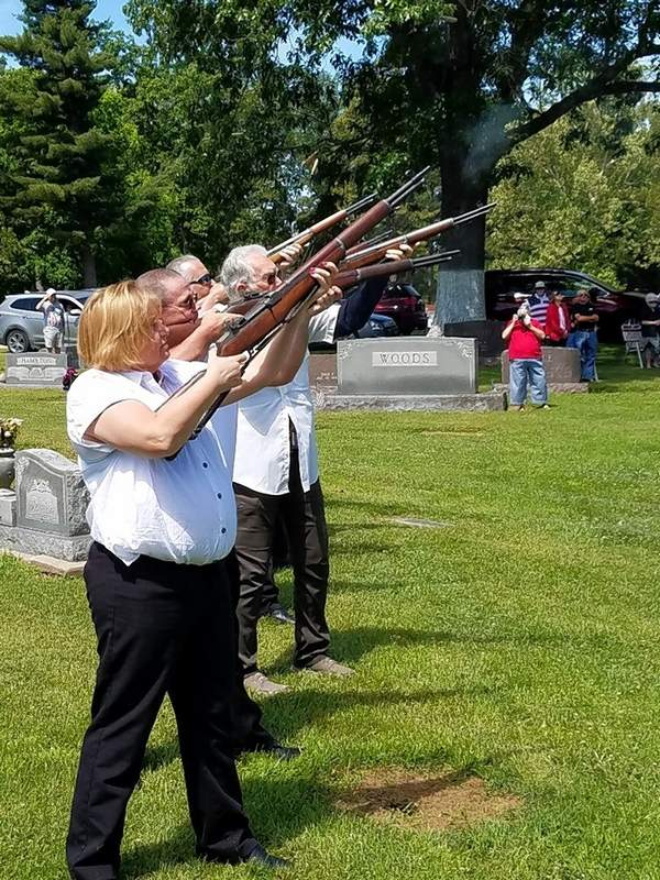 Honor guard member Lora DeLapp takes aim along with other honor guard members at the end of Harrisburg's Memorial Day ceremony Monday.