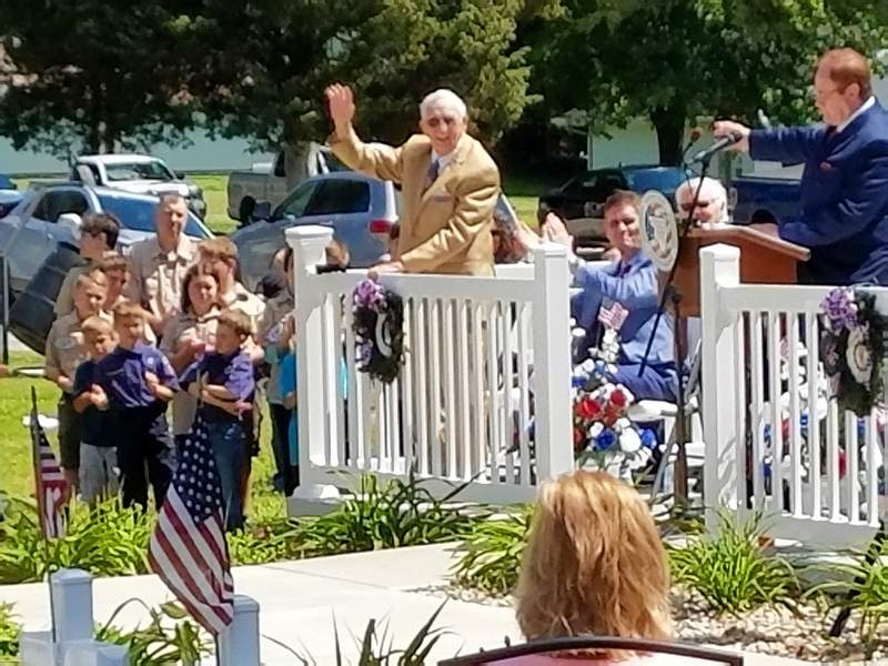 Harrisburg resident and Korean War veteran Don Cooper is recognized for his many years of volunteer work for the Veterans Memorial at Sunset Lawn Cemetery.