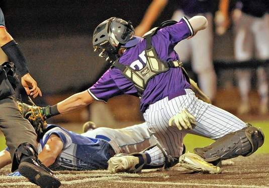 Catcher, Krayton Morse, makes the tag for the out at home plate in the fifth inning thanks to a rocket throw from outfielder Ben Brombaugh.