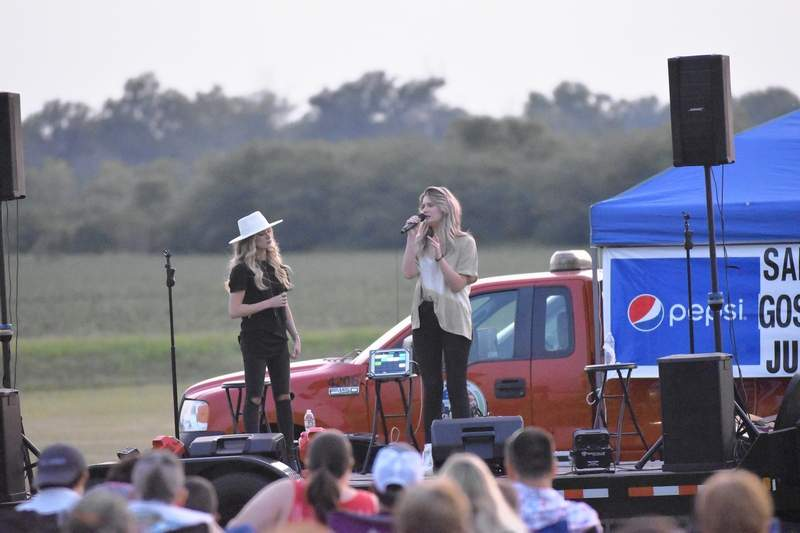 Gospel duo The Peyton Sisters (Rachael Peyton, left, and Riley Peyton) perform at Harrisburg's Fourth of July celebration at a concert sponsored by the Saline Baptist Association. See more photos on page 5.