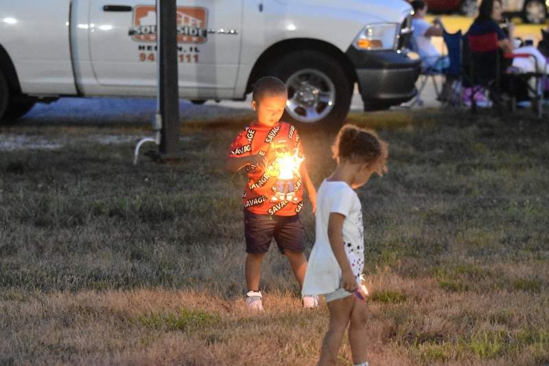 Children play with sparklers prior to Harrisburg's fireworks show Sunday evening.