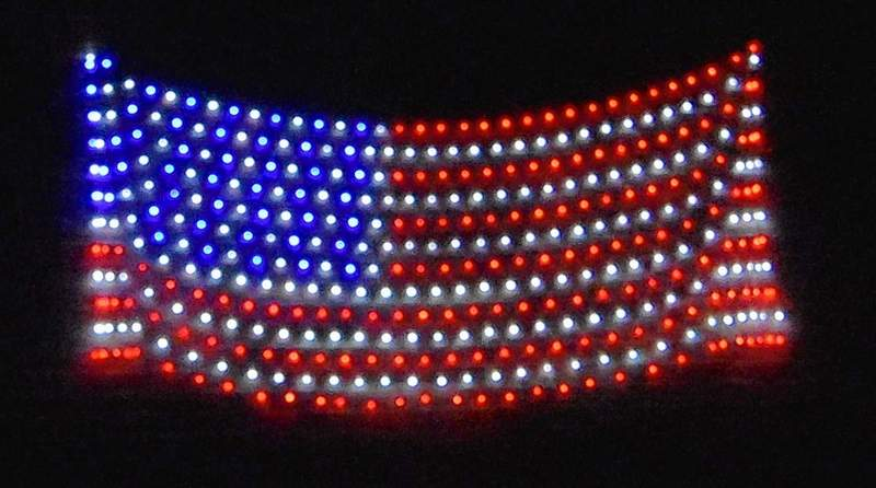 A lighted American flag decoration hands at the home of Melissa and Rodney Valleroy in Rudement during the Independence Day holiday.