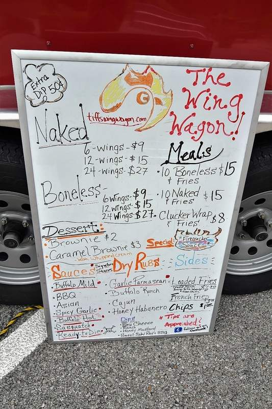The menu board for The Wing Wagon.
