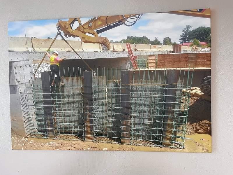 One of her photos shows Karissa Irlbeck working on bridge construction near Galatia.