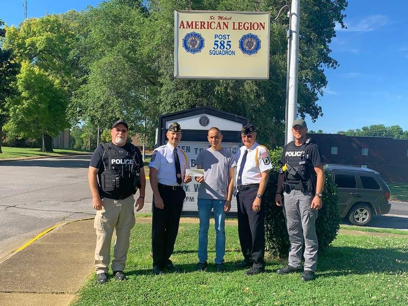 Legion Adjutant Mark Harmon, second from left, hands the $1,000 donation to Shawneetown Mayor David Barker, center. At left is Police Chief Gary Jones, and at far right are Legion Commander Tom Harmon and Officer Nick Capeheart.