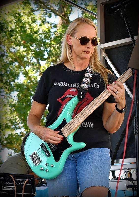 Jodi McKnight is the other half of the band Last Call, where she plays with her dad, Dennis Wilson. She's a doctor by profession.