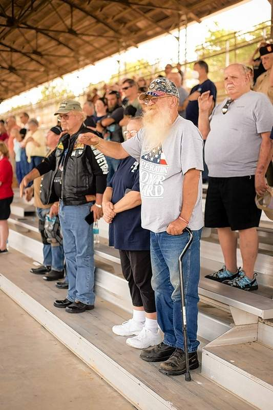 Robert Wallace, U.S. Navy Vietnam Era, joined his many others as they stood in salute during the national anthem Saturday at the Williamson County Fairgrounds following the parade.