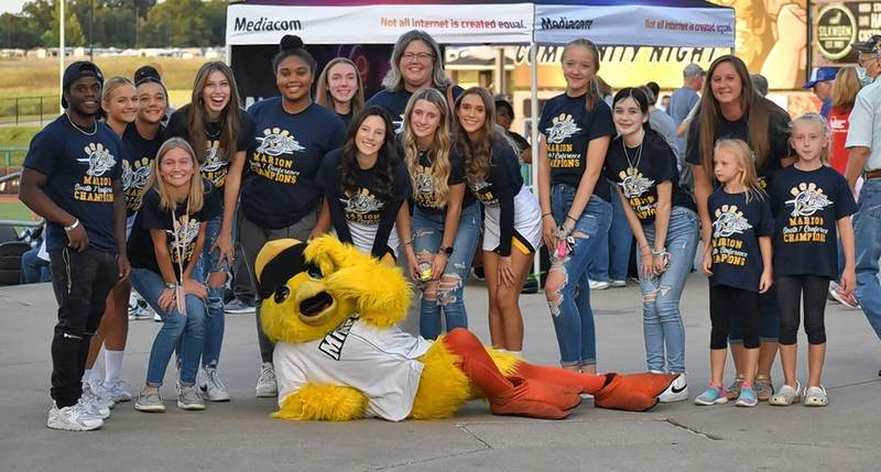 Above, the Marion High School Track Teams pose with Lucky during the celebration of Marion Community Day at Rent One Park.Right, Marion Mayor Mike Absher performed the national anthem on trumpet for Marion Community Day at Rent One Park last week.