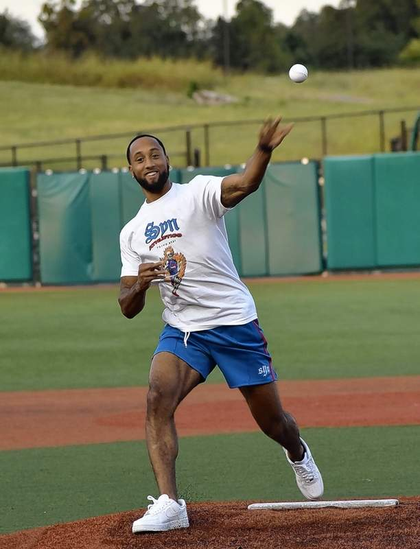 Olympian Darryl Sullivan threw out the first pitch during Marion Community Day at Rent One Park.