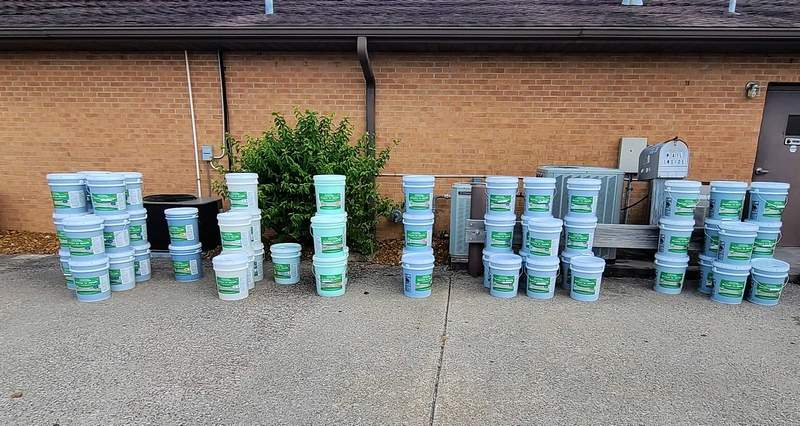 Buckets of laundry soap sit ready for pick up following a fundraisers held by the Williamson County Heartland Rotary.