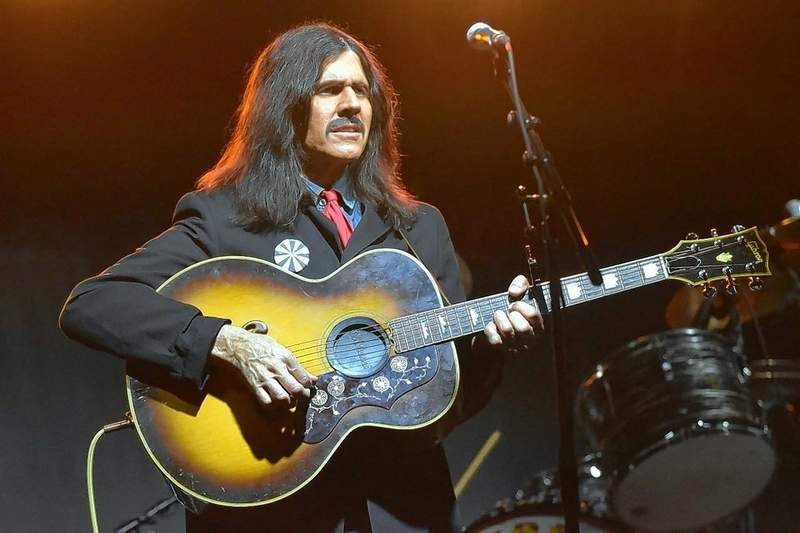 Marty Scott of the Beatles tribute group, the Liverpool Legends, performs as George Harrison at Eldorado Town and Country Days on the Friday night after the marker was dedicated. The band is based in Branson, Missouri.