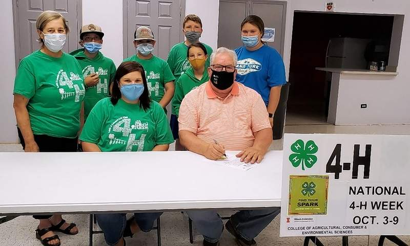Lads & Lassies 4-H members Cayden Baird, Karson Baird, Jocelyn Oxford, Alan Pribble and Lena Stokich with adult volunteers Jeanette Bond and Sara Oxford, came to the Galatia Village Hall to join in the 2021 National 4-H Week proclamation signing with Mayor Steve Sloan.