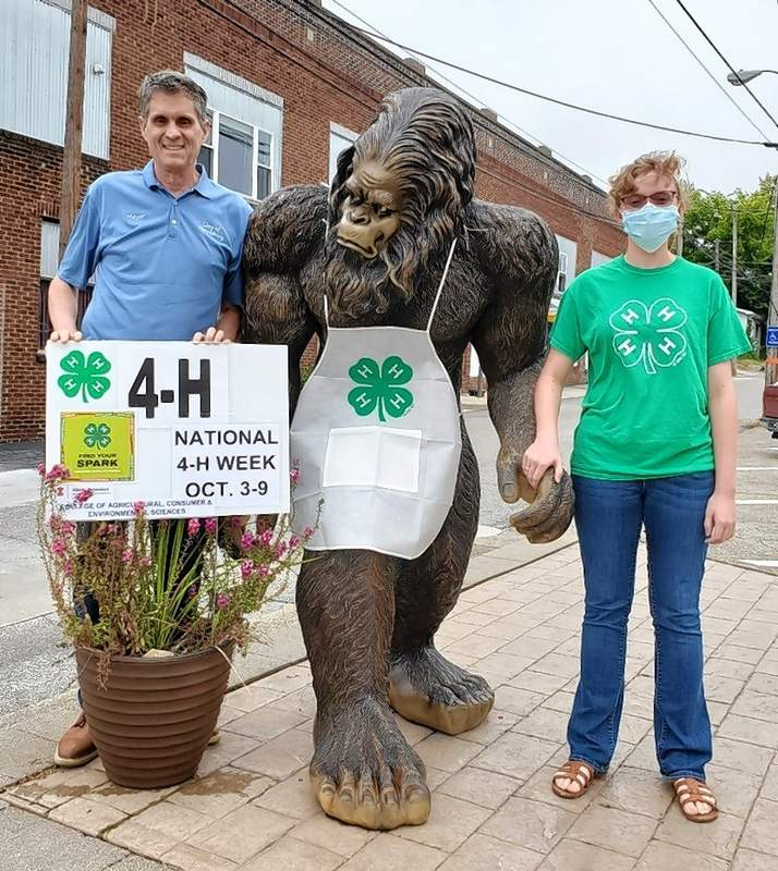 4-H member Rachel Lands joins Mayor John McPeek and Sasquatch for the 2021 National 4-H Week Mayor Proclamation signing.
