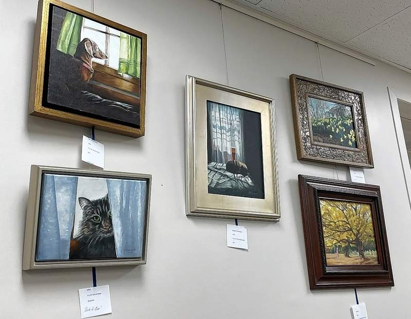 A grouping of Lambert works on one wall of the library.