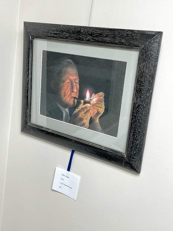 """""""Strike A Light"""" is a work in colored pencil."""