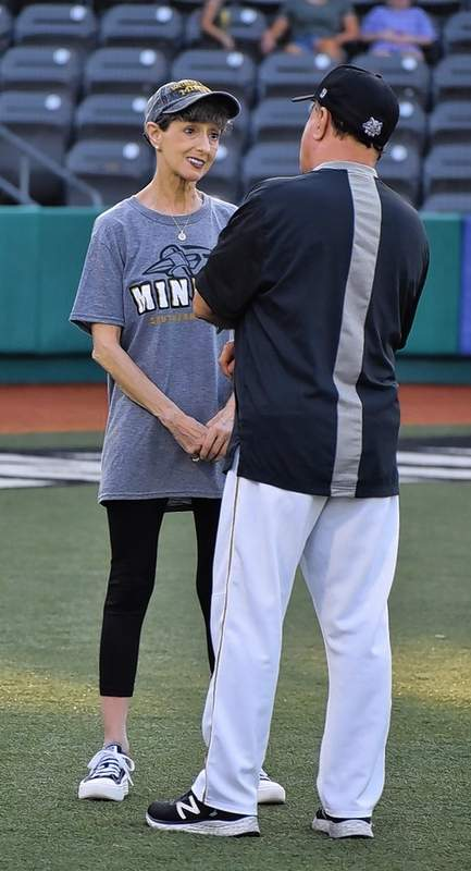 Beth Butler speaks with Miners manager and Chief Operating Officer Mike Pinto prior to the start of one of the last games at Rent One Park.