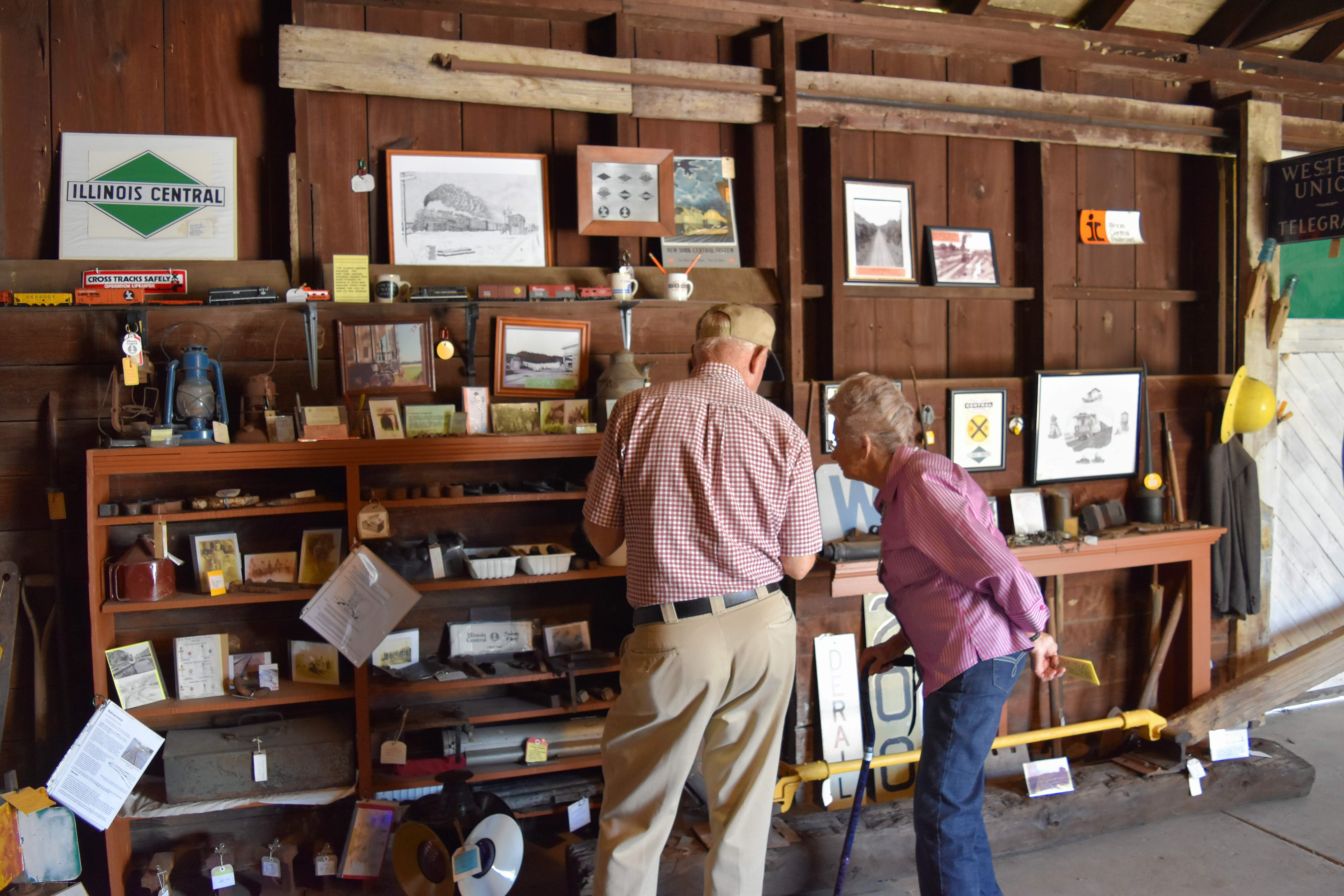 Kenneth Yandell and his wife, Mary, who live near Tunnel Hill, look at a display at the Stonefort Railroad Depot Museum Tuesday afternoon.