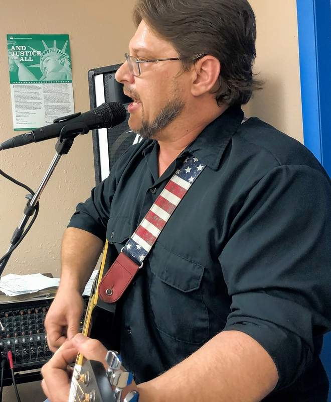 """Michael Gene Craft debuts his newest original song, """"One Last Mountain,"""" during a recent performance at Heaven's Kitchen Marion."""